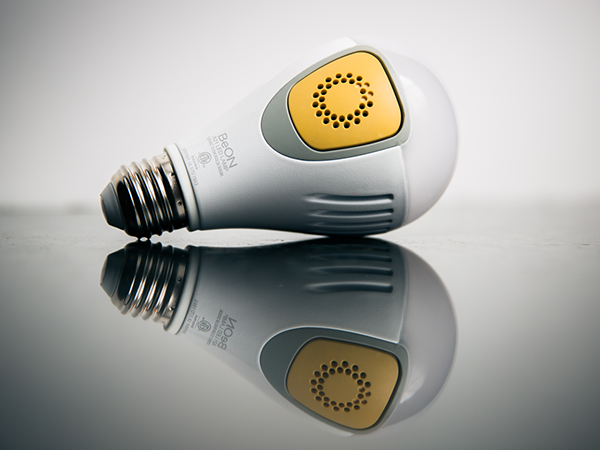 BeON Lightbulb with yellow core on grey reflective surface