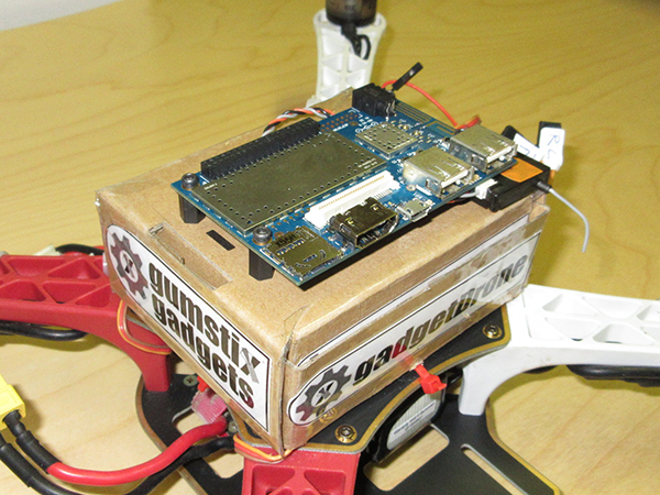 Close up on DragonBoard mounted on drone and cardboard box enclosure