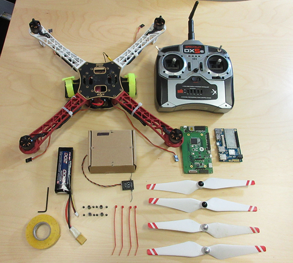 Parts of a quadcopter drone on a table